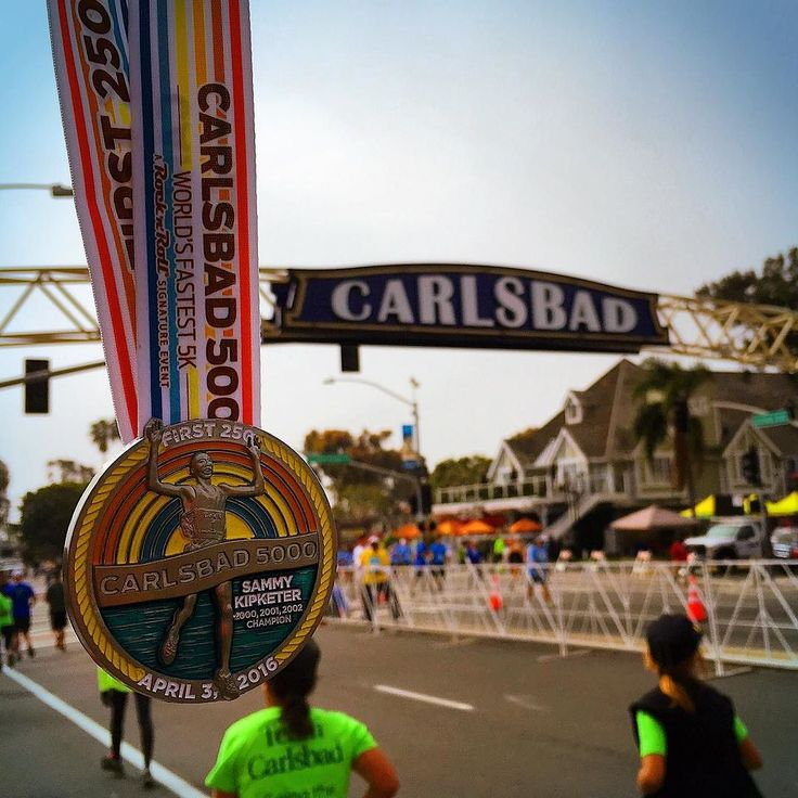 I don't run 5ks very often mostly because they can be pretty pricey for such a short race but it was a blast out in #carlsbad yesterday for the #fastest5k @runrocknroll 's #Carlsbad5000. And I didn't realize that they were giving out the First 250 medals to the first 250 men & women in each wave and both Sean & I earned one of the Sammy Kipketer special medals (I was the 209th female in my wave). If you don't know who Sammy Kipketer is he's only got the Men's world record in the 5000m set in…