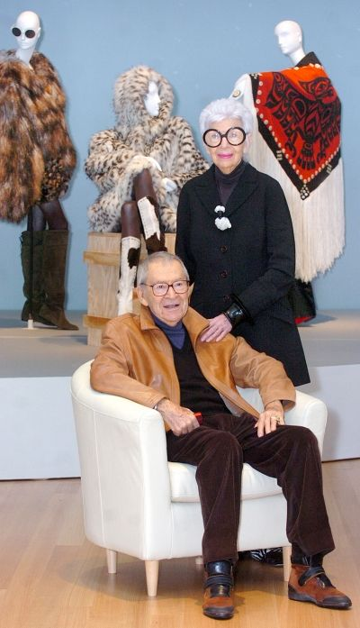 Iris Apfel at the PEM  photo by Patrick Whittemore  Iris and Carl Apfel pose in front of some fashion selections.