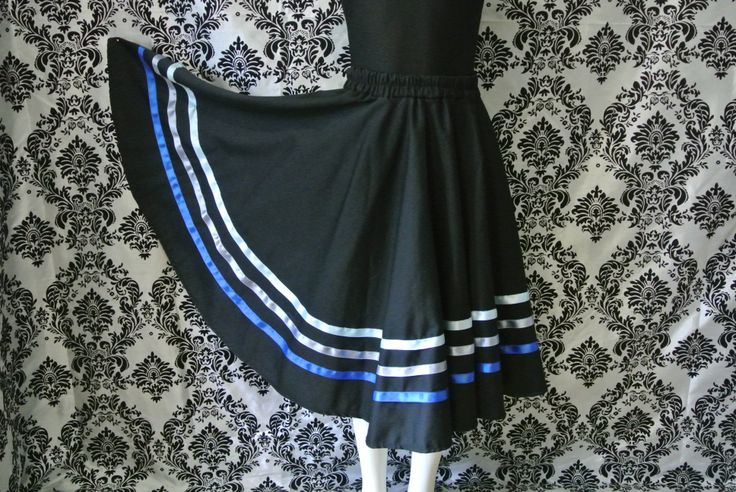 Character skirt with blue ribbons.  https://www.facebook.com/CharacterSkirts