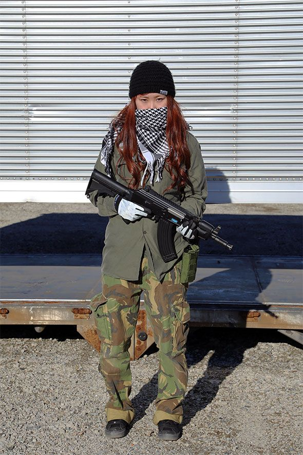 With Japanese girls with airsoft guns shooting phrase
