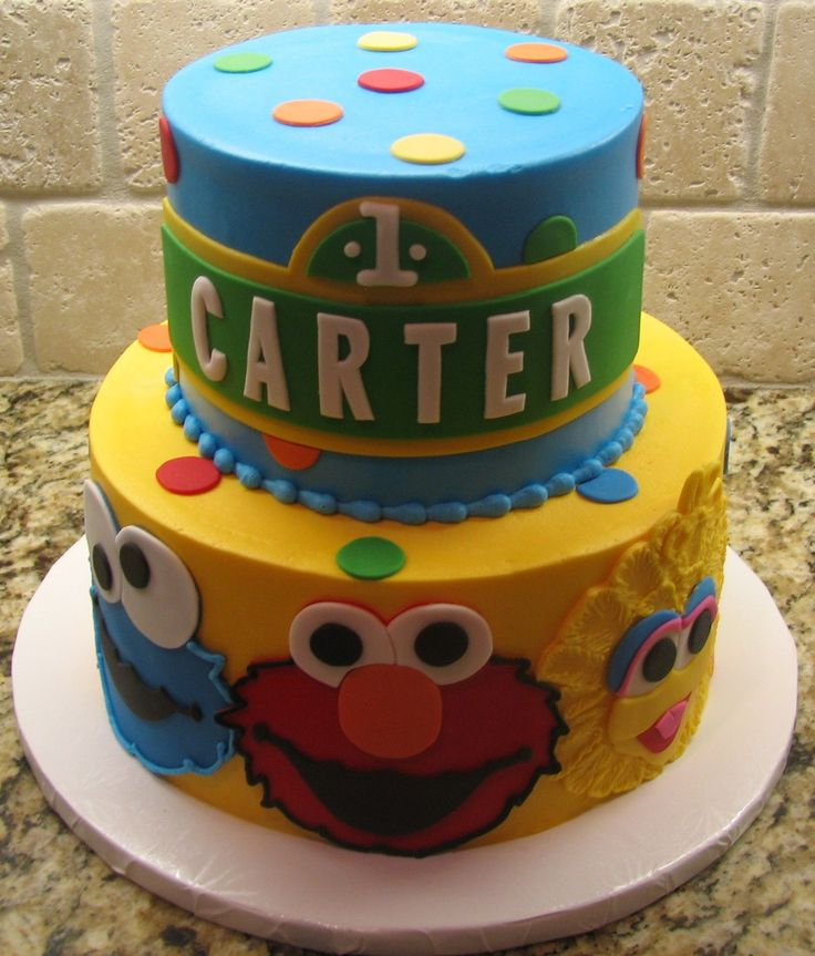 Sesame Steet First Birthday - I did this cake for my nephews first birthday.  The cake is done in buttercream with fondant accents.  All the characters and street sign were cut out of fondant.  I made a smash cake of Elmo's face to match.  I was inspired for this cake by one I recently saw on here by kawaiicakecook.
