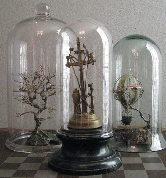 I'm an absolute sucker for a good bell jar or glass dome display.  There is just such a plethora of options for how to fill them, how to use...