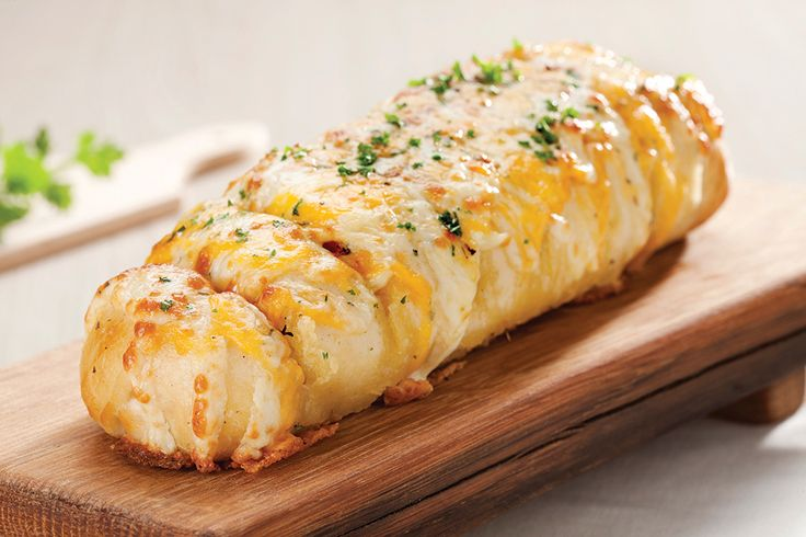 Cheesy Garlic Sub. A delicious sub made with garlic butter, smothered in mozarella cheese and baked until crispy | Panarottis http://www.panarottis.co.za/ourmenu/tostart