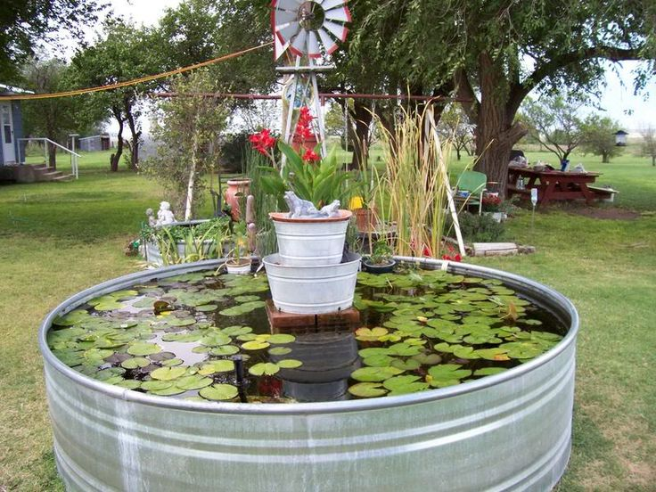 Cattle trough pond with home made water fountain garden for Home water ponds