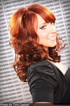 second angle of picture of red medium curly hairstyle