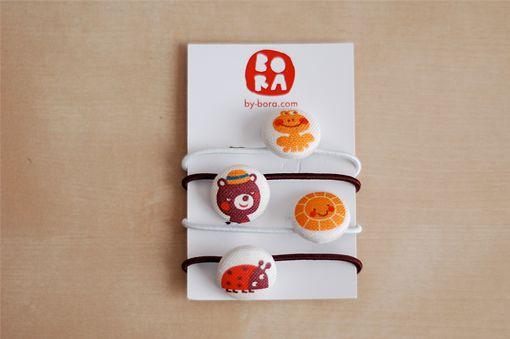 bambiblauw blogt ook...: Tutorial: haarelastiekjes met Bora knoopjes