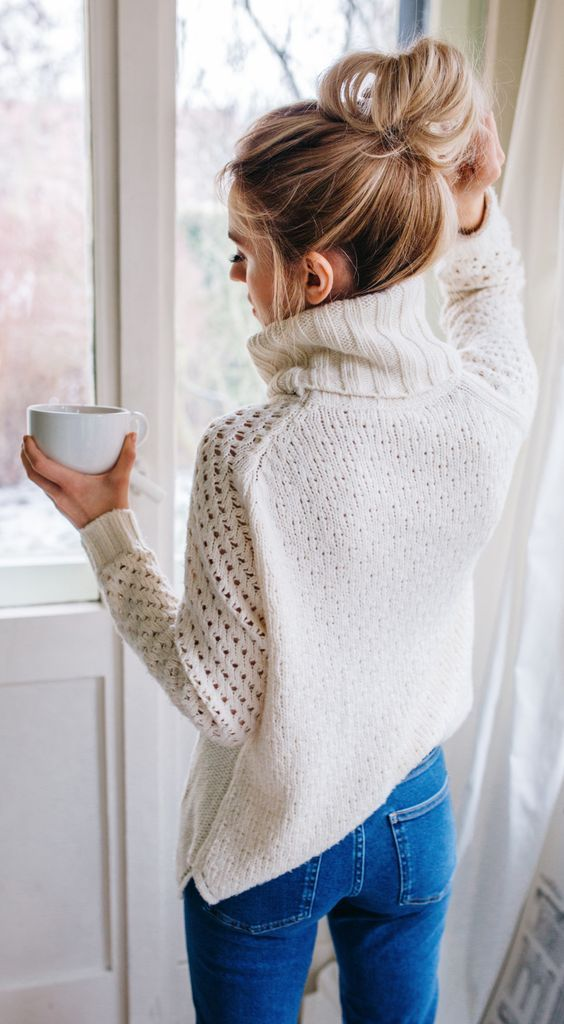 Cozy sweater and bun. Winter weekend