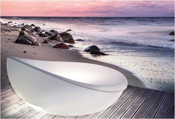 LAGOON DAYBED | BY SOLPURI  This stylish bed was designed by Klaus Nolting and comes equipped with led lighting and a protective cover that you can close when the sun is to harsh. The bed also comes equipped with a control allowing you to rotate the bed in the sun´s direction.