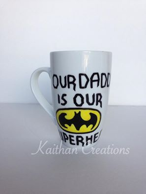 12oz Our Daddy is our Superhero Batman mug by Kaithan Creations.  Can be personalized. Visit my Facebook page to place your order. https://www.facebook.com/kaithancreations/photos/a.218304591702629.1073741829.216663808533374/489576701242082/?type=3
