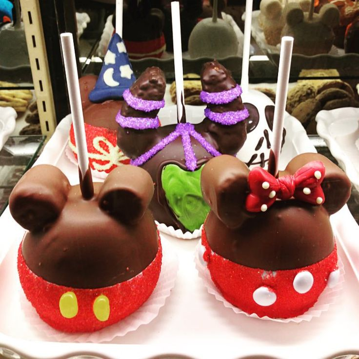 Nothing cuter than Mickey and Minnie in caramel apple form! #Disneyland Day 2.