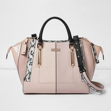light pink dipped top winged tote bag by River Island. Leather look fabric Dipped top with wing detail Snakeskin pattern panels Grab handles and shoulder strap Gold tone hardware Height 27cm, width 49cm, handle drop 16cm #riverisland #bags
