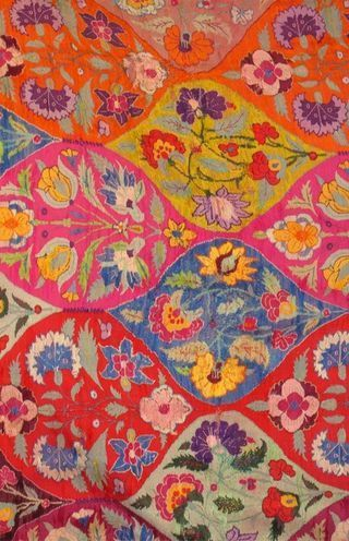 Contemporary rug with a typical Indian jaali pattern of vibrant florals