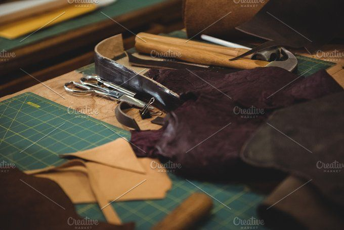 Leather piece on table by WavebreakPremium on @creativemarket