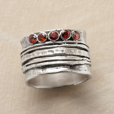 """CINQ RING -- Five garnets sparkle atop five variegated bands of hand-hammered sterling silver, making beautiful harmony. Whole sizes 6 to 10. 1/2""""W."""