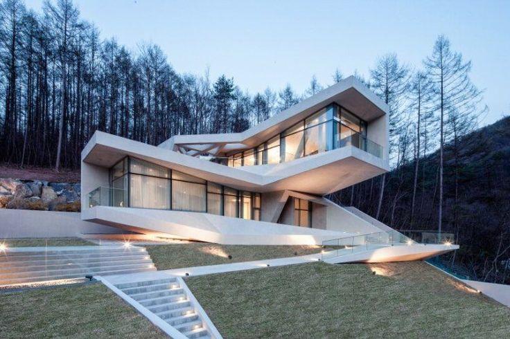 maison-béton-fenetres-panoramiques-allée-éclairage-led