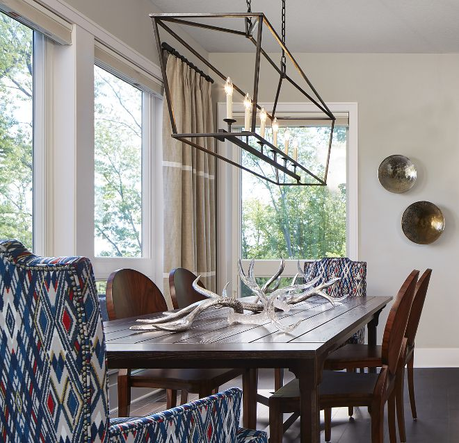 Beautifully Decorated This Dining Room Feature Floor To Ceiling Windows And A Liner Chandelier Over The Table Linear Is Darlana Pendant