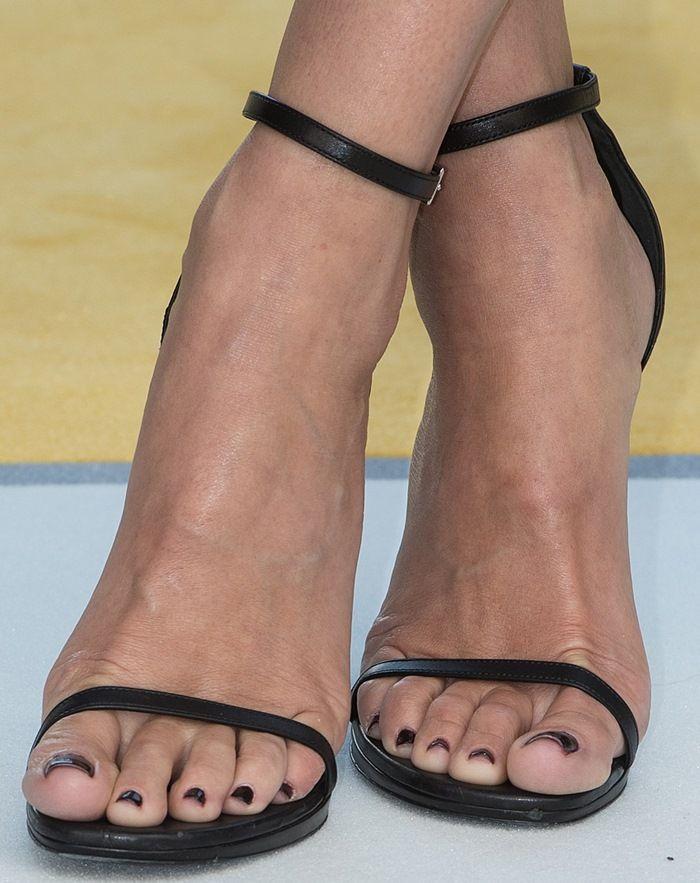 Sandra Bullock in Stella McCartney and Saint Laurent Heels