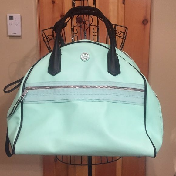 Mint green lululemon bag The prettiest color with tons of room!! Has additional strap to attach yoga mat. Needs a cleaning on the inside. Can be cleaned. Outside in good condition. no trades. Offer button only! lululemon athletica Bags