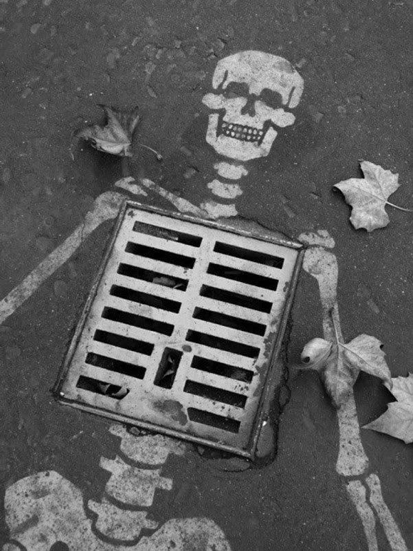 Creative skeleton. For a high school art lesson, have students take chalk outside and find something ordinary and turn it into something extraordinary then take a photo of it and print it out. Could even overlay the image with text and turn it into a poster.: