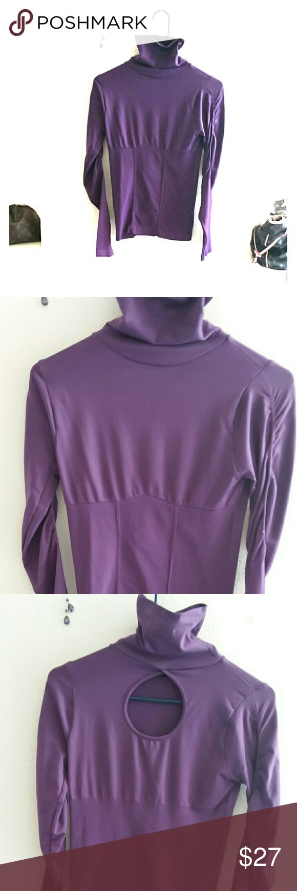 BEBE ● FUN PURPLE SEXY TOP W/ KEY HOLE IN BACK !! BEBE ●  FUN FITTED PURPLE SPANDEX & GATHERED JUST PERFECTLY ON THE ARMS & WAIST !!  WITH A SUPER SEXY KEY HOLE OPENING ON THE BACK OF THE TOP OR YOU COULD WEAR IT WITH IT IN FRONT TOO !!  NEVER WORN !!! bebe Tops
