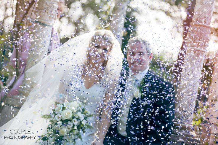 The bride & groom get lost in a sea of confetti. Weddings at Killashee House Hotel photographed by Couple Photography.