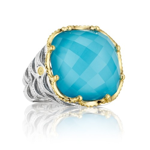 "Transparent Quartz over Neolite Turquoise makes this strong statement of style an absolute marvel in ""Barbados"" blue. Layered gemstones create a dazzling, multidimensional look, framed in rich 18k yellow gold with sculptural crescent-woven side details."