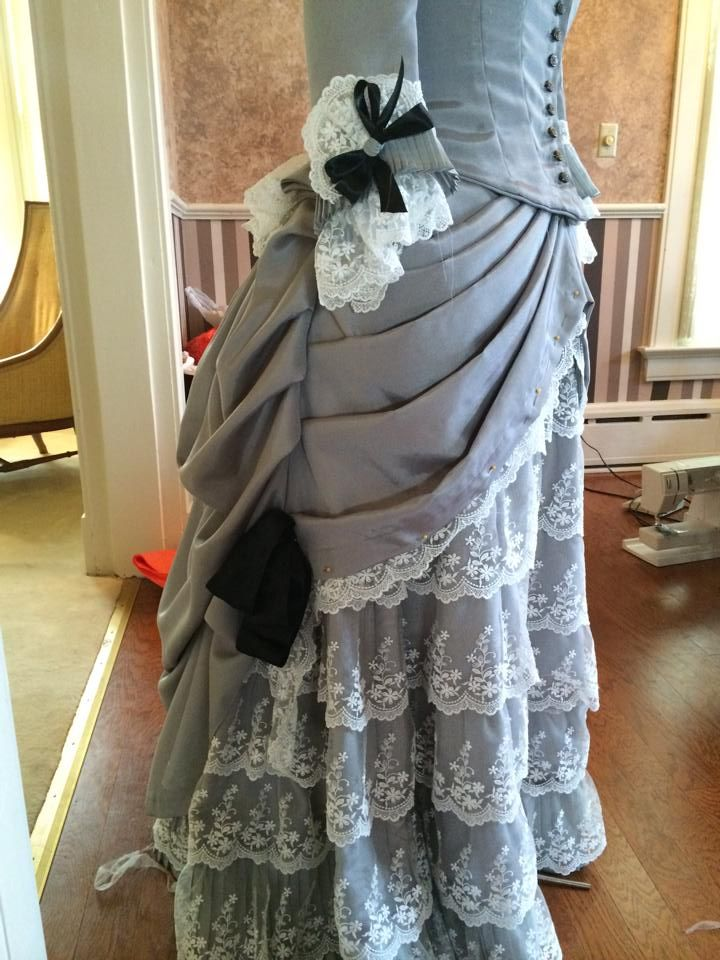 1883 dinner gown, progress shot.  Used Truly Victorian TV462, modified to add a peplum at the back.  Overskirt is TV326, the Hermione overskirt, hitched up a bit in the front to more closely match the transition to the late bustle period.  Foundation skirt is taken from Janet Arnold, with miles and miles and miles of lace basted onto it.