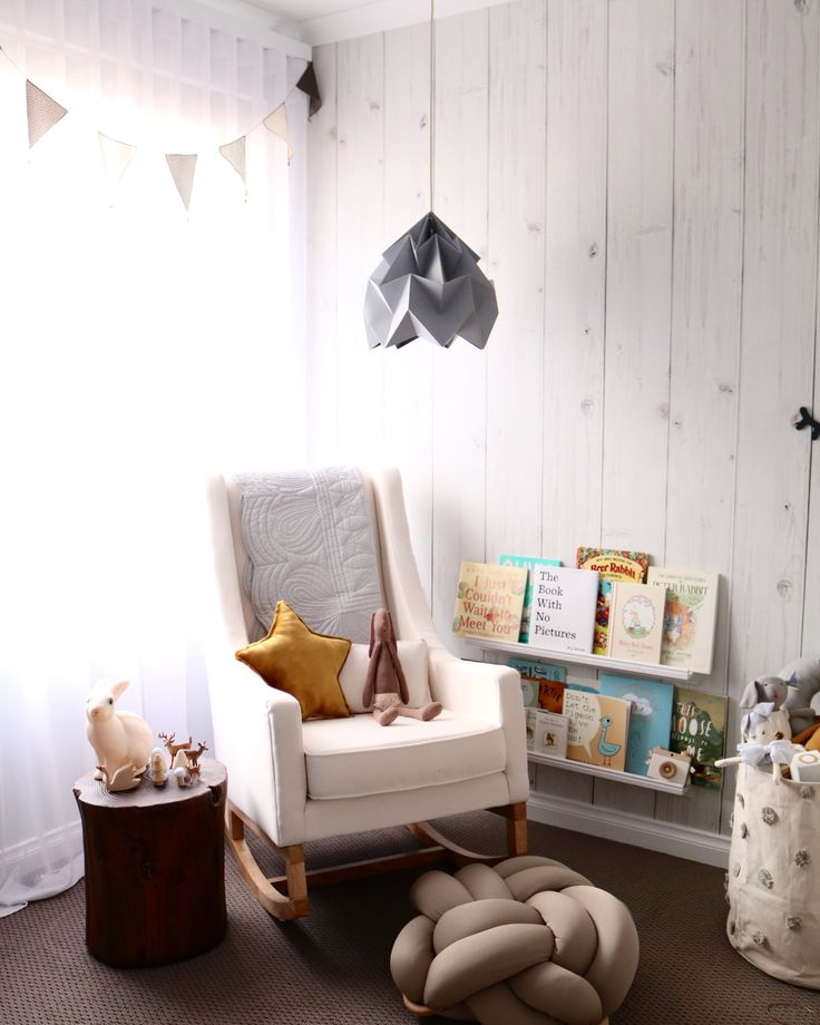 Gender Neutral Baby Nursery Room- with a touch of mustard. Wood look wall paper and rocking chair