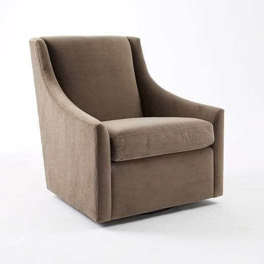comfortably curvy the sweep swivel armchair is a deepseated take on the classic reading chair sweeping arms a swiveling seat and a graceful silhouette