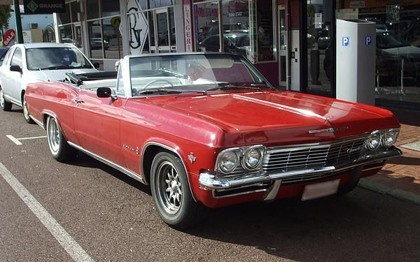 Red 1965 RHD Chev Impala Convertible. Probably here since new.