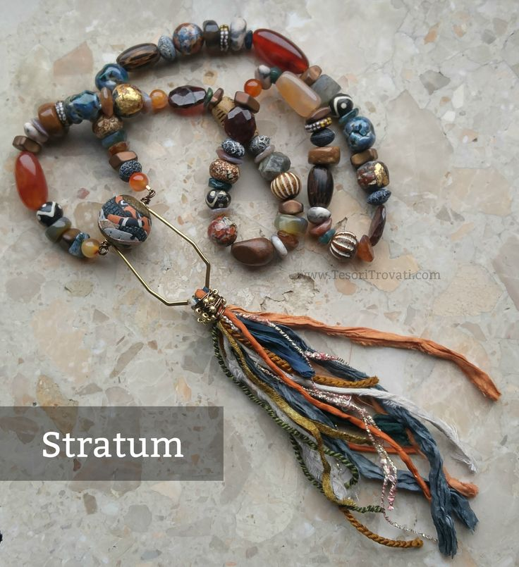 May 2017 :: ABS Stratum - layers upon layers of stone, ceramic, bone, wood with a handmade polymer clay Stratum bead from Tesori Trovati and a gold diamond bead frame festooned with various fibers by Erin Prais-Hintz