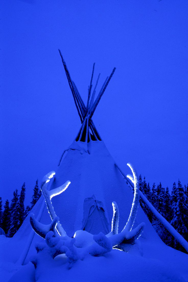 Snow covered tipi and antlers - Blachford Lake Lodge, Yellowknife, NT
