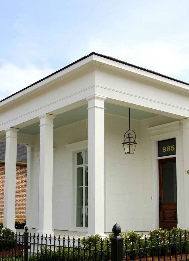 beautiful square columns...built by J Hand Homes, with Haint Blue porch ceiling, stained antique wood front door with transom, and Bevolo French Quarter style gas lantern