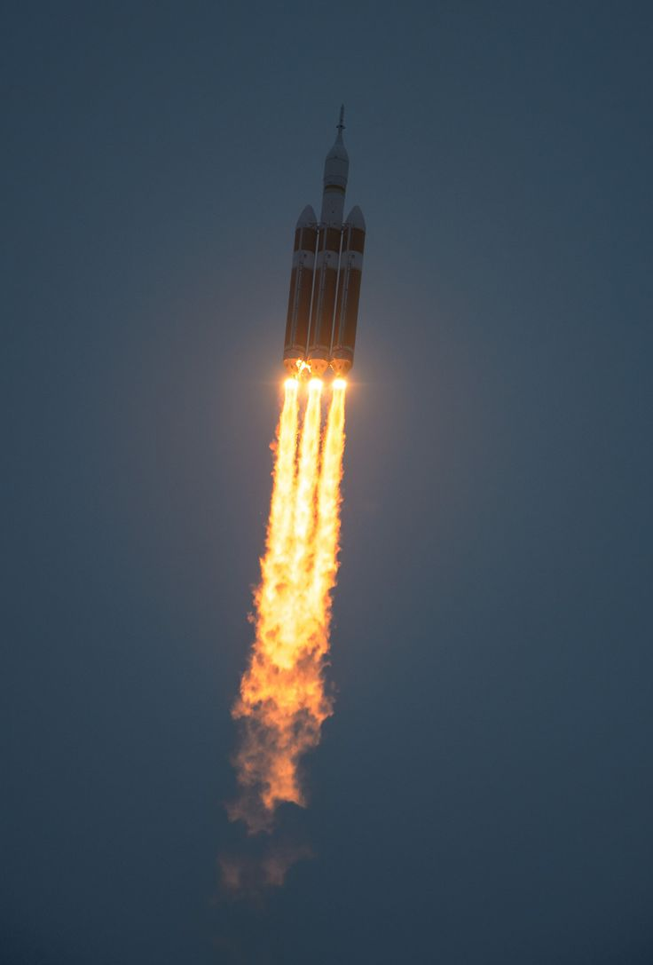 The United Launch Alliance Delta IV Heavy rocket with NASA's Orion spacecraft mounted atop, lifts off from Cape Canaveral Air Force Station's Space Launch Complex 37 at at 7:05 a.m. EST, Friday, Dec. 5, 2014, in Florida. The Orion spacecraft will orbit Earth twice, reaching an altitude of approximately 3,600 miles above Earth before landing in the Pacific Ocean.