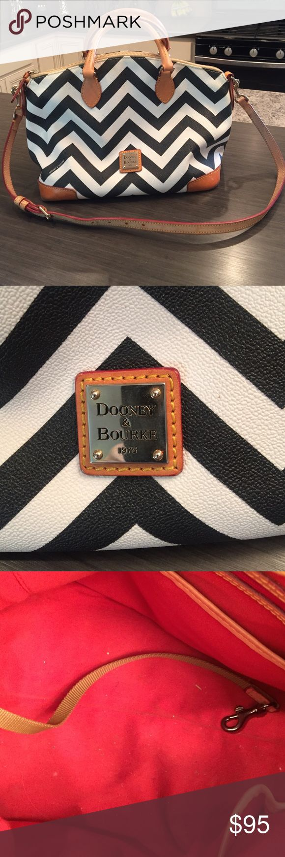 Dooney & Bourke handbag in black and white chevron Black and white chevron with tan leather trimming.  Some wear on corners and pen marks on inside.  In great shape and really cute!  Just have way to many bags. Dooney & Bourke Bags Satchels