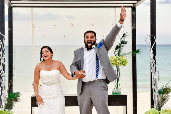 Bride and groom celebrate leaving their nontraditional Indian beach wedding in Playa del Carmen, Mexico | Playacar Palace #destinationwedding
