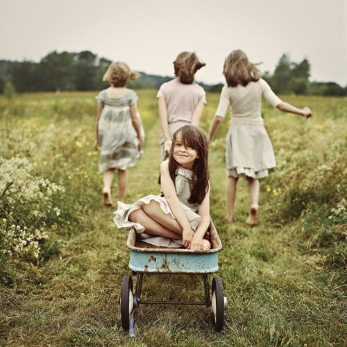 kids girls outside playing play grass field smile laughter fun