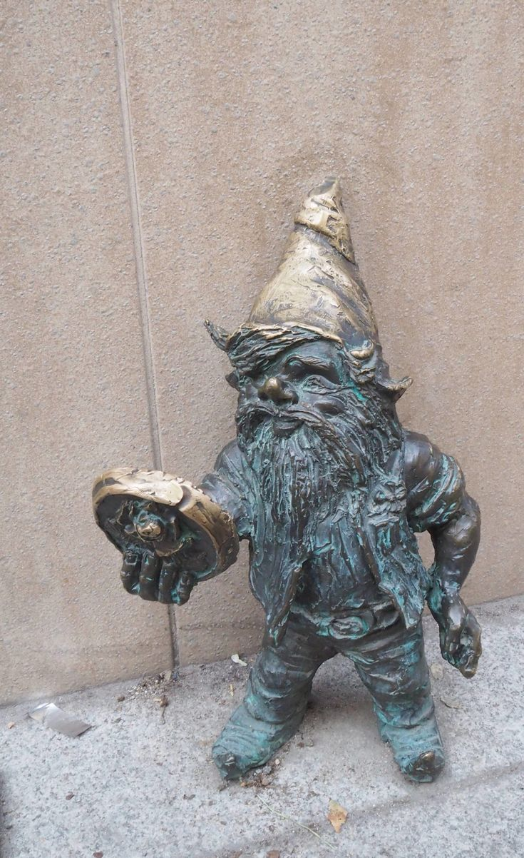 Poland Travel Inspiration - Hunting for Dwarfs in Wroclaw. One of our favourite things to do in Wroclaw was to hunt out the dwarfs / gnomes which are dotted around the old town and further afield. Buy a map at the tourist office or download from the web (link in the blog post). I loved Wroclaw and it is one of Europe's lesser know city break destinations. Click to see more photos.