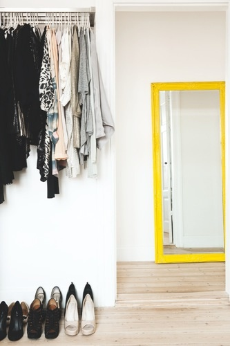 A pop of colour with the yellow mirror.