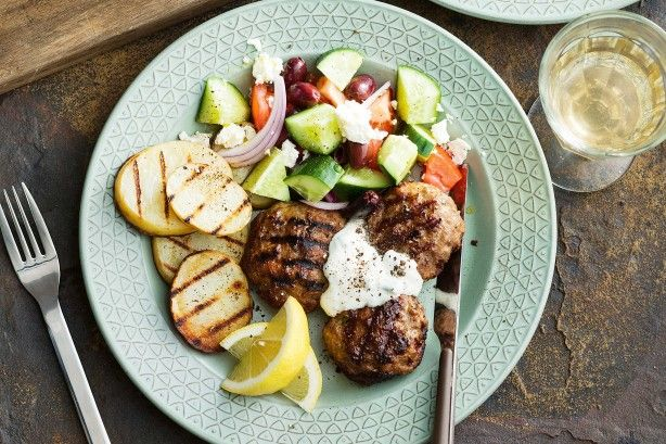 Fire up the barbecue to make these zesty lamb rissoles, served with potato slices and fresh Greek salad.