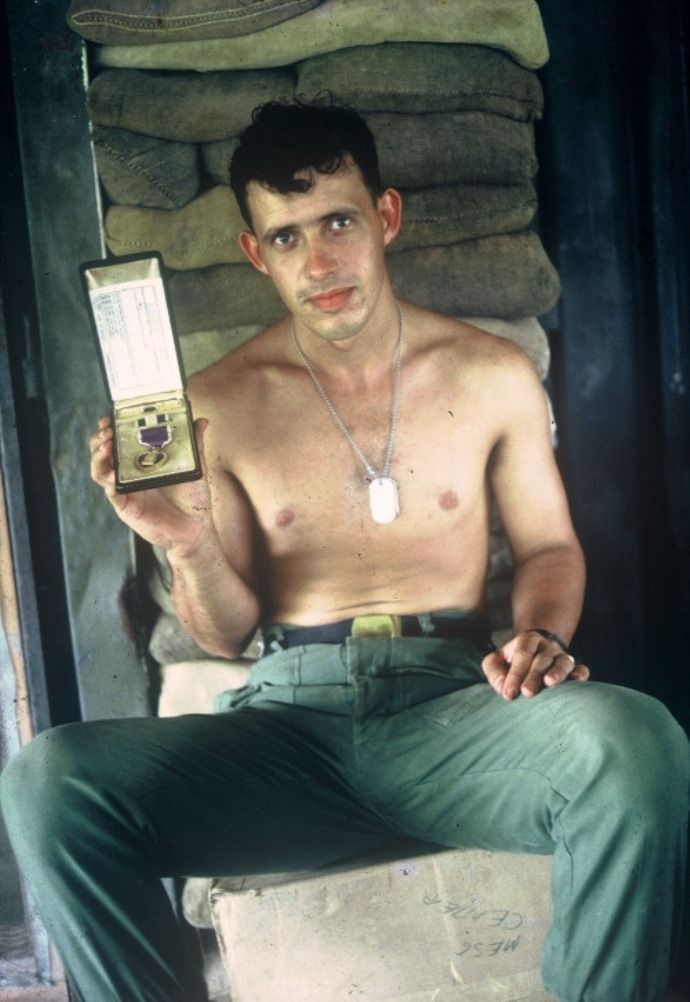 Soldier Otto Leonard, 25th Infantry Division, showing his first Purple Heart medal.