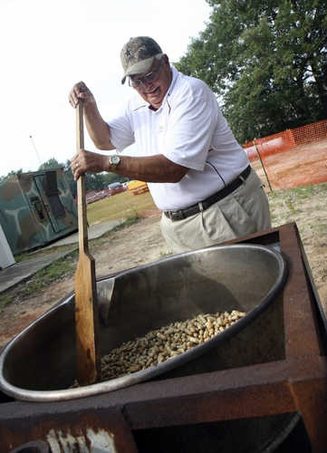 Charles Haggard, the mayor of Pelion, stirs a pot of boiled peanuts as he has done every year since the South Carolina Peanut Party's inception 31 years ago. He estimates 50-60 bushels of peanuts will be boiled for the event. The 31st annual South Carolina Peanut Party continues Saturday 8 a.m. to 11 p.m.The event features a parade, dog show (dog and owner look-a-like and best dressed dog contest), a peanut butter and jelly sandwich eating contest, car show, peanutty recipe contest and local ent