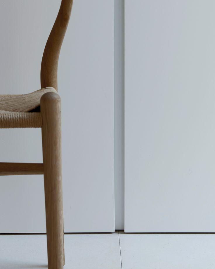 Koetsier - Van der Velden studio •     Interior executed by Nieuwkoop International. Bespoke interior. Minimalistic modern design. Interior details. White lacquer cabinet. Limestone tiles.
