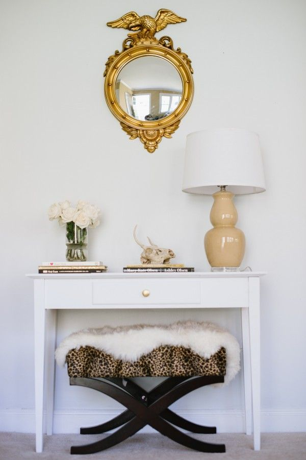 Neutral & Rustic: This entry way feels classic and inviting and incorporates basic elements like a great mirror, gourd lamp, fresh flowers and coffee table books. The leopard bench gets toned down with a sheepskin fur.