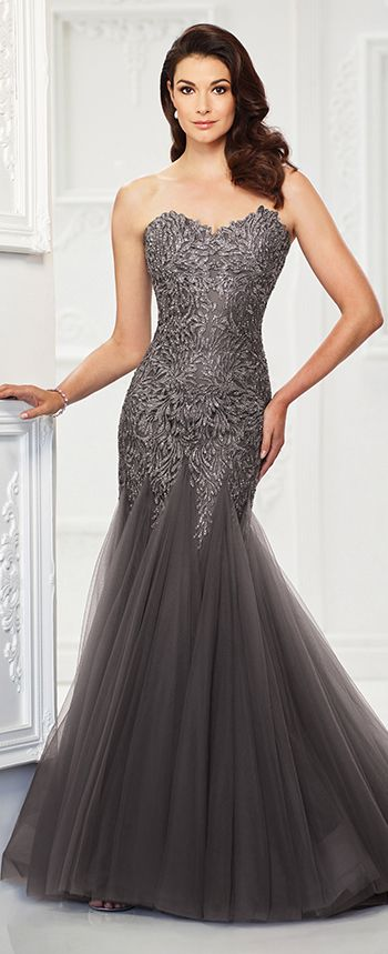 This gorgeous strapless tulle trumpet gown with unique lace appliqués and heat set stones offers a sweetheart neckline, a beaded lace appliqué bodice with a dropped waist, a tulle inset flared skirt with a chapel train. A matching shawl and removable straps are included.