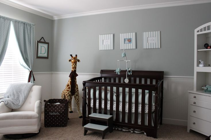Nursery: grey walls, blues and browns and polka dots.