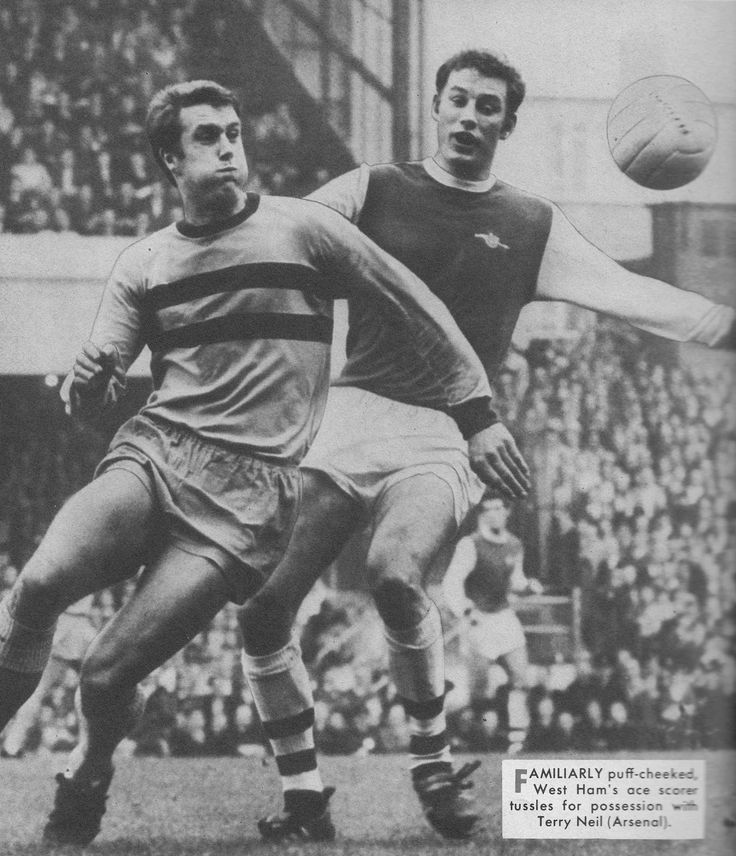 26th October 1968. West Ham United centre forward Geoff Hurst tussling with Arsenal captain Terry Neil.
