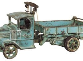 """Toy truck, Arcade Mack cast iron dump truck, embossed Mack on both sides of closed C cab, spoke wheels & nickel-plated driver, VG cond w/orig blue paint, 12.25""""L."""
