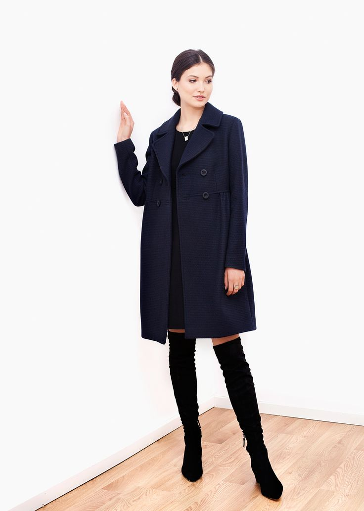 Paris wool coat navy. Crafted from a navy wool mix, this coat features distinctive feminine notes - high waist, subtle folds and rounded lapels. Both chic and comfortable, it brings a sense of relaxed, joyful elegance to your wardrobe.
