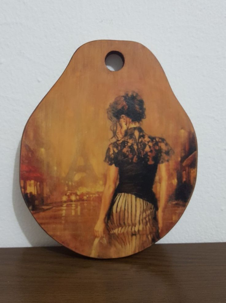 DIY image transfer that I did and slightly painted on wooden rounded cutting board